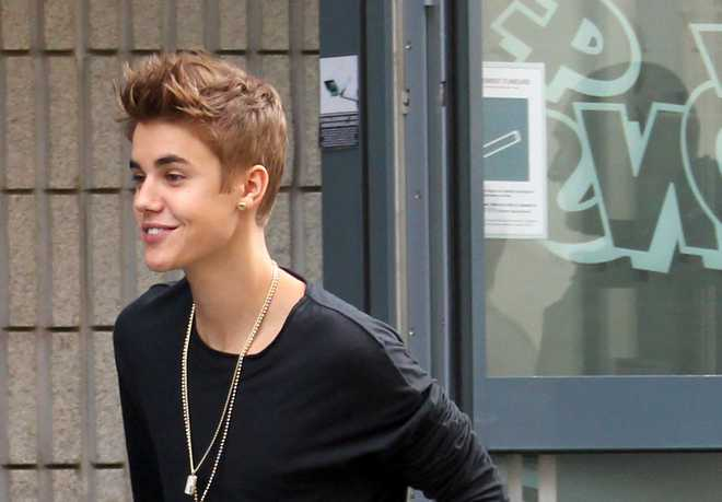 Justin Bieber Greets His Fans at NRJ Radio