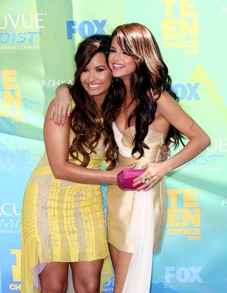 Selena Gomez and Demi Lovato at The 2011 Teen Choice Awards - Arrivals in LA