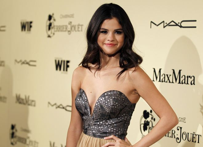 Actress and singer Selena Gomez poses at the Women In Film pre-Oscar cocktail party at Cecconi's in West Hollywood