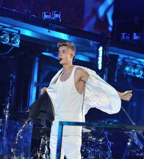 PARIS : Canadian singer Justin Bieber performs live at Palais Omnisports