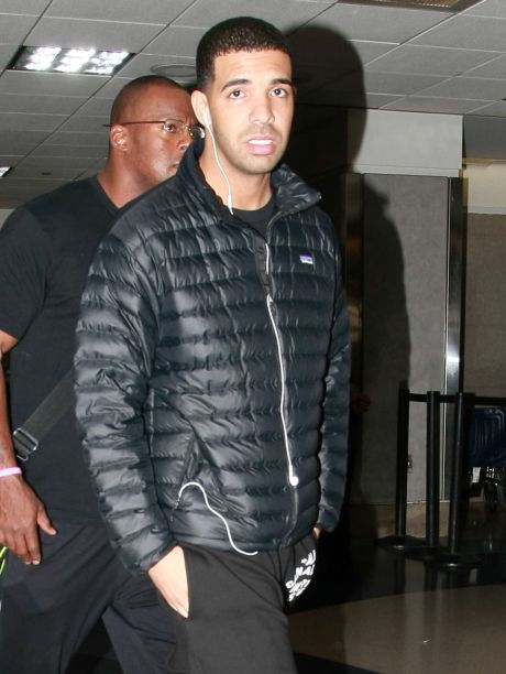 Exclusive: Drake Arriving On A Flight At LAX