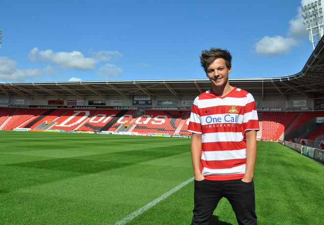 Britain Soccer One Direction Tomlinson