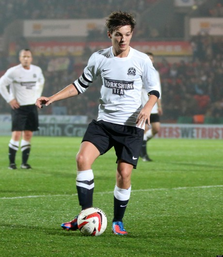 Louis Tomlinson, Harry Styles, Niall Horan, Liam Payne and his girlfriend Eleanor Calder at the Keep Moat stadium on Doncaster