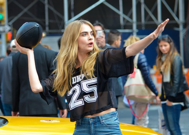 Cara Delevingne Plays Football On Photo Shoot