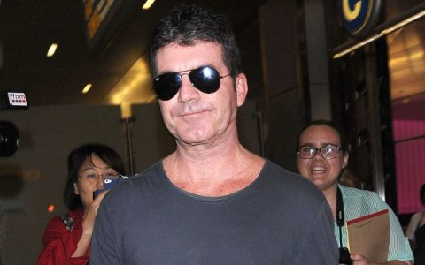 Simon Cowell Arriving On A Flight At LAX