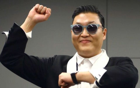 PARIS : South Korean rapper Park Jae-Sang also known as Psy gestures during a press conference
