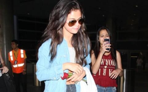 Selena Gomez & Cara Delevingne Arriving On A Flight At LAX