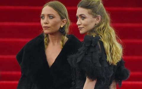 Mary-Kate and Ashley Olsen arrive at the 2015 Met Gala in New York City